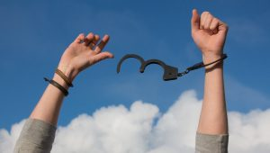 Hands in the air breaking free from handcuffs